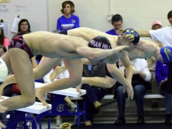 District champ Vester shows 'metal' for swimming
