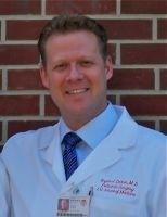Dr. Bryan J. Dicken